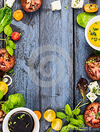 Free Salad Making, Food Frame With Oil,vinegar, Tomatoes, Basil And Cheese On Blue Rustic Wooden Background, Top View Stock Photo - 53648280