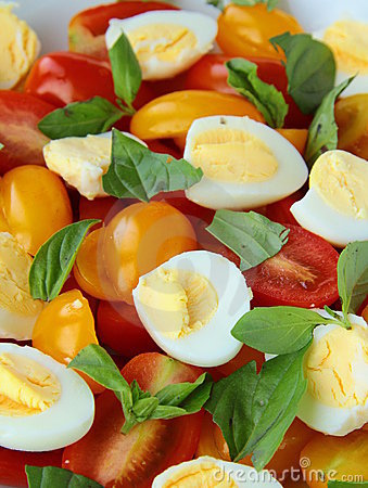 Salad with quail eggs and cherry tomatoes
