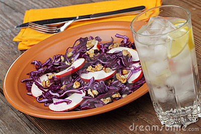 Salad with red cabbage, apples, and walnuts