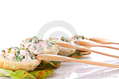 Salad in tortilla and spoons