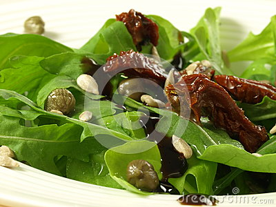 Salad with wild rocket and tomatoes