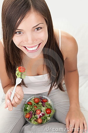 Salad woman eating healthy