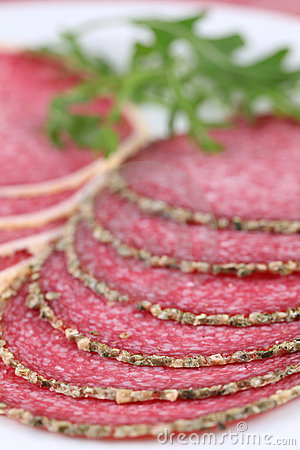 Salami with pepper and parmesan crust