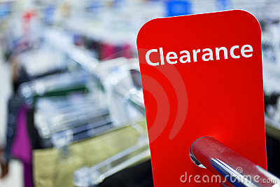 Sale Clearance Sign On Rail in Clothes Shop