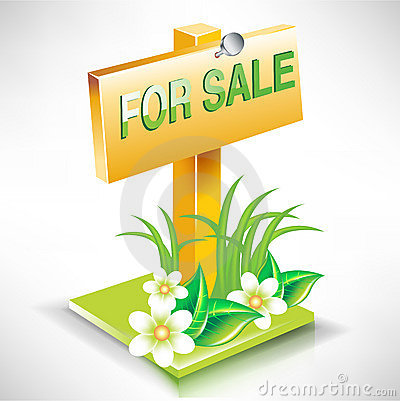 For sale real estate plate sign on land