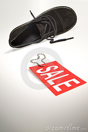 Sale sign and shoe