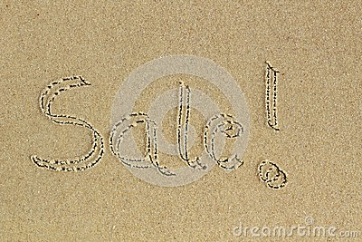 Sale word handwritten as text on sand in a beach