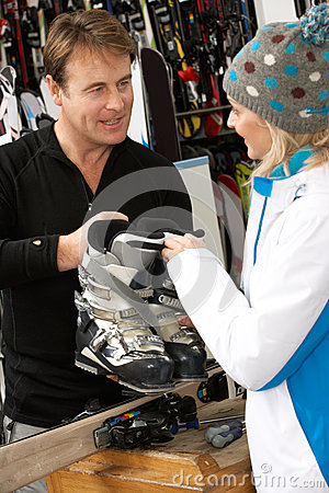 Sales Assistant Advising Customer On Ski Boots
