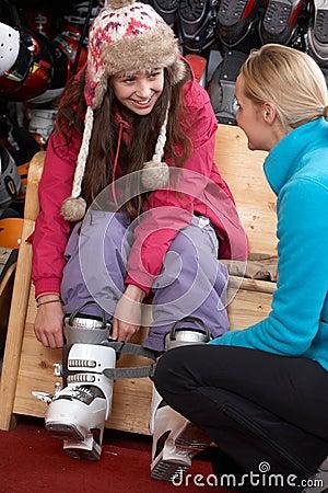 Sales Assistant Helping Teenage Girl