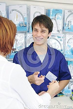 Sales clerk receiving  credit card, vertical