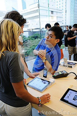 Sales Person And Customer In Apple Store Stock Photography - Image: 26769412
