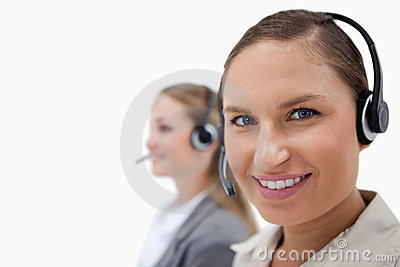 Sales persons using headsets