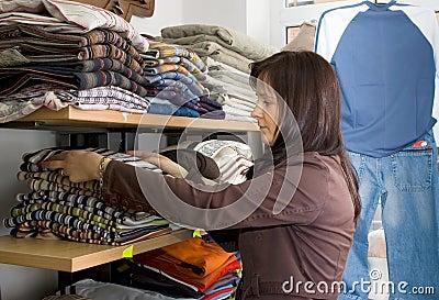 Saleslady in a jeans wear shop