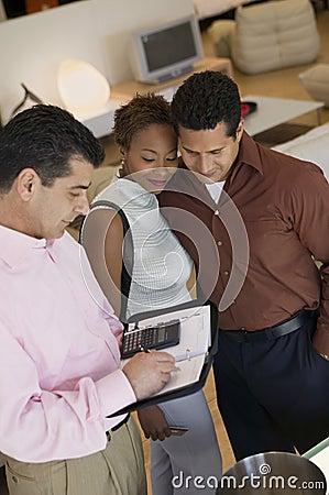 Salesman Calculating Purchase Amount of couple