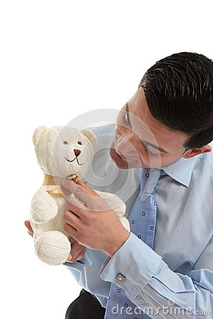 Salesman holding a teddy bear