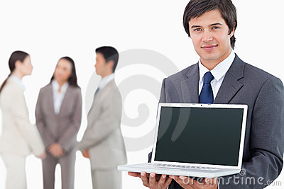 Salesman showing laptop screen with colleagues