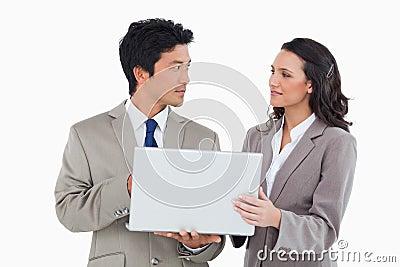 Salesteam working on laptop together
