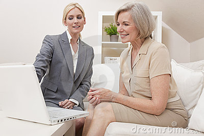 Saleswoman Advising Senior Woman Laptop Computer
