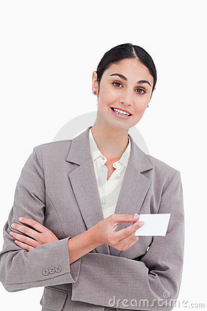 Saleswoman with arms folded and business card