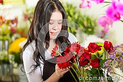 Saleswoman in a flower shop