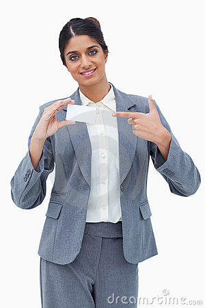 Saleswoman pointing at blank business card