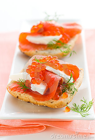 Salmon appetizer with red caviar