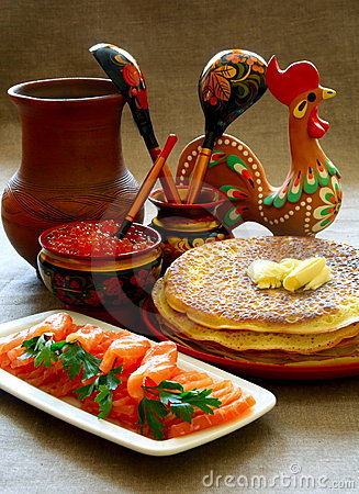 Salmon fish and caviar with pancakes.