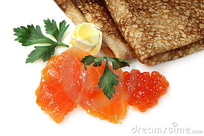 Salmon fish and caviar with russian pancakes