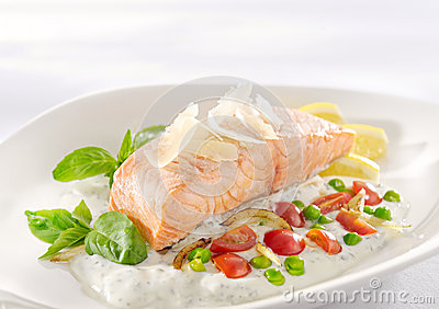 Salmon in herb cream sauce