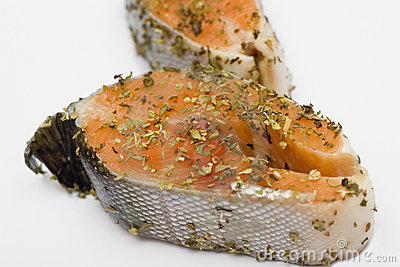 Salmon in herbs marinade prepared for cooking