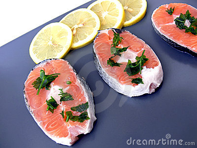 Salmon and lemon on plate