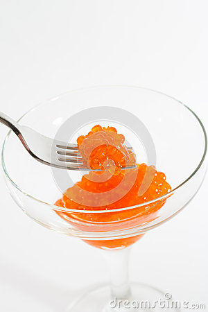 Salmon roe in goblet with fork