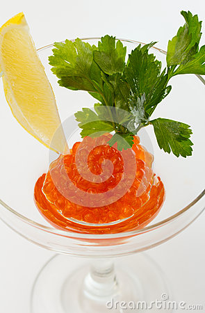 Salmon roe in goblet with lemon and parsley