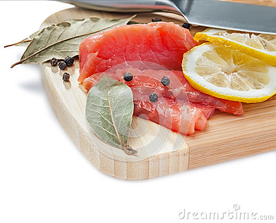 Salmon slices on the wooden board
