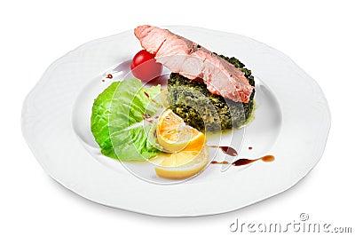 Salmon with spinach garnish