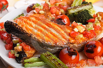 Salmon steak with garnish