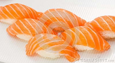 Salmon sushi nigiri on white plate and background