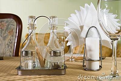 Salt, pepper napkin and a glass