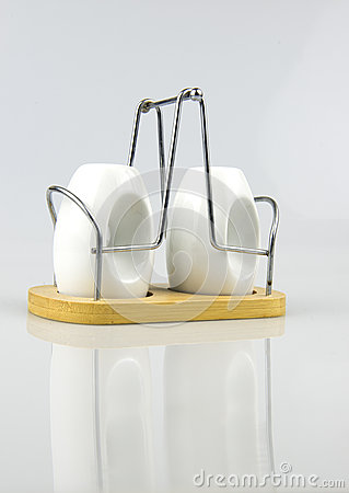 Salt and Pepper Shaker Made Of Porcelain on a wood and metal support