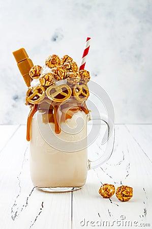 Free Salted Caramel Indulgent Extreme Milkshakes With Brezel Waffles, Popcorn And Whipped Cream. Crazy Freakshake Trend Royalty Free Stock Image - 95245396