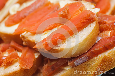 Salted red pieces of fish on a bread. delicacy food