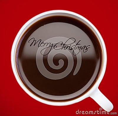 Saludo de la Navidad, gráfico en superficie del café
