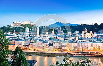 Salzburg skyline with river Salzach at dusk, Salzburger Land, Austria