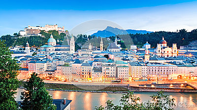 Salzburg skyline with river Salzach at dusk, Salzburger Land, Austria