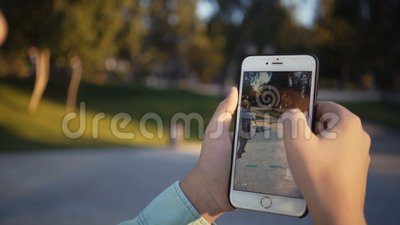 Samara, Russian Federation - August 14, 2018: the guy is playing in Walking dead our world with augmented reality on his. Iphone. Walking dead our world - fight stock footage