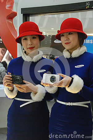 Samsung camera with show girls Editorial Stock Image