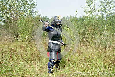 Samurai with sword in defense combat position
