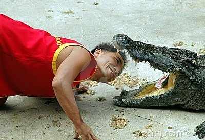 Samut Prakan, Thailand: Man with Crocodile Editorial Stock Photo
