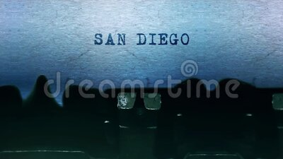 SAN DIEGO words Typing on a sheet of paper with an old vintage typewriter. stock video footage