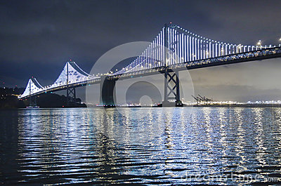 Illuminated Bay Bridge in San Francisco. The Bay Lights is an iconic light sculpture designed by artist Leo Villareal Editorial Photography